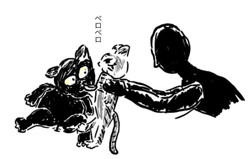 子猫をなめてやる黒猫